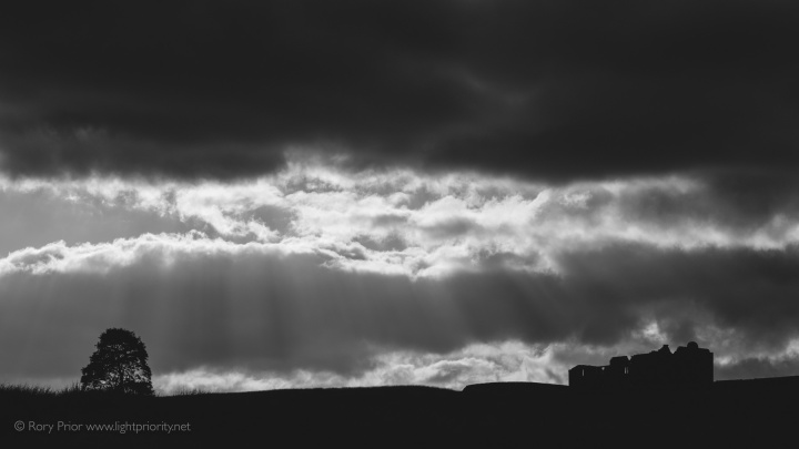 Crepuscular rays in the sky over the ruined Red Dykes farmhouse.